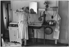 Grandmother washing dishes.. From Duke Digital Collections. Collection: William Gedney Photographs and Writings. Mark: Stamp. Date of print: 1971 Sept..: