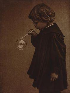 Child Blowing a Soap Bubble  Heinrich Kühn (German, 1866–1944)  c. 1910. Bromoil transfer print