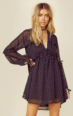 We're in love with this sweet and feminine mini dress by For Love and Lemons. Featuring a polka dot print throughout, neck tie detail, and ruffled loose fitting sleeves.   ImportedDry Clean OnlyPoly C