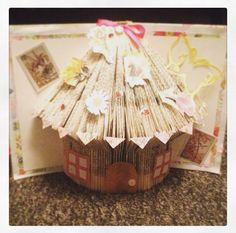 Book folding fairy house I made with 1 book and cut out embellishments and fabric to cover book very easy to make