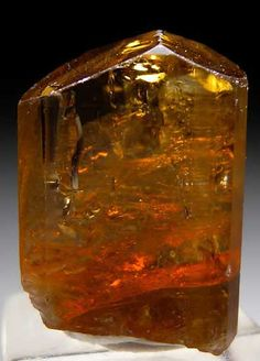 TU92 - Dravite $ 125 SOLD Mwajanga, near Komolo, Tanzania thumbnail - 2.1 x 1.4 x 1.0 cm - Gemmy golden brown crystal from a new find. Excelent quality and good sized with majority of backside contacted.