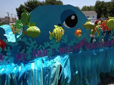 Parade Float: Hawaii themed... DIY Parade float, wood dolphins or palm trees on jump standards