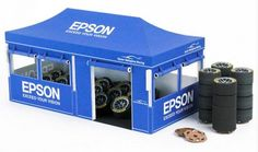 Tire Tent Paper Model In 1/24 Scale - by Epson Nakajima Racing - == -  This nice paper model of a Tire Tent with its acessories came from Japan, offered by Epson Nakajima Racing website. This model is in 1/24 scale, but you can resize it to 1/32 to fit in slotcar sceneries.