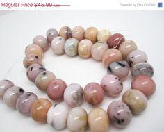 SALE Pink Opal Beads, Pink Peruvian Opal, Pink Opal Rondelles, 12mm x 15mm Rondelles, Smooth Rondelles, Loveofjewelry, Weddings, SKU 4122A by loveofjewelry on Etsy https://www.etsy.com/listing/218439333/sale-pink-opal-beads-pink-peruvian-opal
