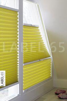 Plisse gordijnen van Label 65 kunnen ook in trapeze vorm gemaakt worden waardoor u zelfs in hoekramen hiermee uit de voeten kunt!