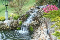 Backyard Ponds And Waterfalls...I like the waterfall, here, but used too many small rocks, for my tastes!