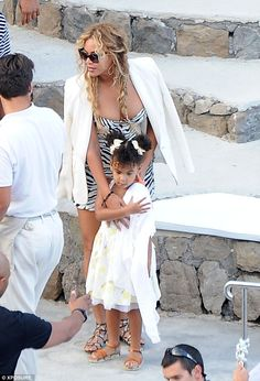 Family holiday: Beyonce showed off her holiday style in a tiny zebra-print playsuit as she hit the water in Capri with husband Jay Z, their precious daughter Blue Ivy and close pal Kelly Rowland and her family