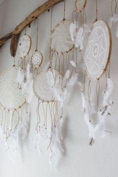 Make these, @Sarah Dalton …. simple white feathers and hemp string on dream catchers <3