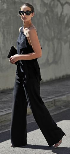 Sara Donaldson + perfect silhouette + one-shouldered vest top + pair of flared culotte trousers + striking nature + all-black style.   Top: Dion Lee, Trousers: Christopher Esber, Bag: Daily Edited.