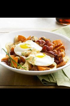 Sweet potato hash with spicy hollandaise on a bed of bacon. YUM! Here's the recipe:) http://moderndaymoms.com/sweet-potato-hash-with-spicy-hollandaise-on-a-bed-of-bacon/
