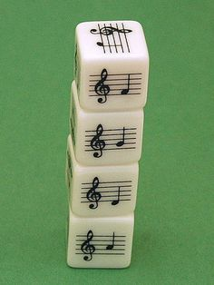 Musical Notes Dice - A must-have for teaching music! The teacher is a Suzuki violin teacher, but many items can be used for piano, and she does have charts for Suzuki piano. Good stuff.