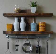 Handmade spice rack shelf with pot rack. Slight offset for that unique look. Perfect for any home kitchen, apartment, or country cottage.  It has been