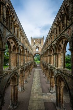 Jedburgh Abbey Scotland - the great abbey church of St Mary the Virgin stands almost entire. The eastern end has Romanesque architecture of the highest quality. Its solid cylindrical pillars stand in contrast to the more delicate Gothic nave, with its graceful sweep of arcades and magnificent west front. photo by John Cobb, 500px