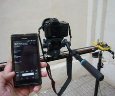 """This instructable shows how to make a motorized camera slider. Actually we attach some additional parts to a manual slider to make it motorized and controlable by an Android phone. The idea behind camera sliders is to give you the ability to video """"tracking shots"""" and time lapse videos that you can set up and execute in seconds. Tracking shots create a sense of movement, as if the camera was a passerby briefly filming the subjects on screen. They add professionalism to your work, gi..."""