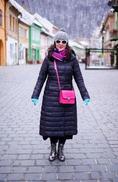 winter outfit: long black winter coat, grey beanie, pink bag, minty mittens, wool pink scarf, oversized white glasses