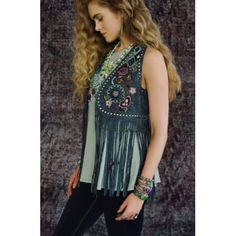 """This Butterfly Bleu Biker Vest is an essential piece this Spring!Inspired by theclassic fringed hippie vests, Double D Ranch has made it their own by adding floral folk embroidery and nickel nailheads. Made from soft sheep leather and gently distressed for a vintage look and feel. Bust on the XS measures approx. 34""""."""