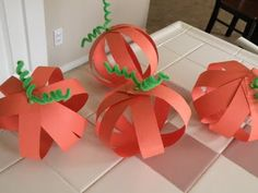 made these with my kids last Halloween super easy looks great!!! 2 brads and strips of paper we also did the same concept for ordiments for christmas!!