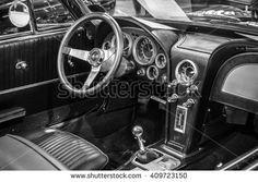 "STUTTGART, GERMANY - MARCH 18, 2016: Cabin of sports car Chevrolet Corvette Roadster Black Old-School Resto Mod, 1967. Black and white. Europe's greatest classic car exhibition ""RETRO CLASSICS"""
