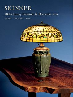 20th Century Furniture & Decorative Arts | Skinner Auction 2552B  The June 25, 2011 20th century design auction in Boston includes Art glass lamps and a daffodil decorated fire screen by Bigelow & Kennard, Tiffany art glass and lamps, Georg Jensen silver, and mid-century modern Mexican hollowware. A substantial collection of Clarice Cliff pottery with whimsical decoration will brighten your spring. Furniture is highlighted with great examples of Danish mid-century modern, much of which came…