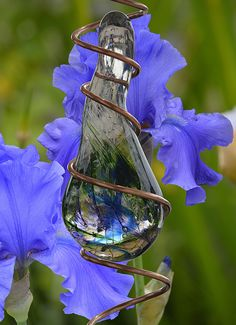 https://flic.kr/p/U1NT5x | Going Mobile | A creative spiral and glass mobile in front of some pretty flowers . .  as it spins... it gives the illusion of ascending . . .