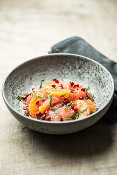 Citrus salad with pomegranate, mint and cinnamon honey