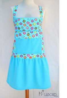 Full Apron made of fabric with printed turquoise small apples. In the central part has a large pocket which is divided into two;-one larger than...