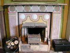 The fireplace in Clive Bell's study at Charleston, with mantelpiece decoration by Vanessa Bell
