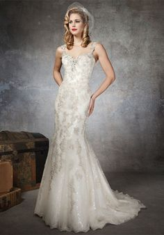 Gown features beading and lace.    Silhouette: Mermaid  Neckline: Sweetheart  Waist: Dropped  Gown Length: Floor  Train Style: Attached  Train Length: Chapel  Sleeve Style: Cap  Fabric: Tulle, Lace, Satin  Embellishments: Beading, Lace  Color: Silver or Gold  Size: 4 - 32  Price: $$$