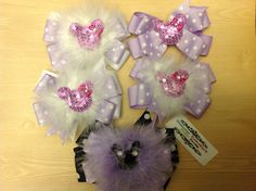 Any choice hair bow with marabou $8 and $7 plain.  Www.facebook.com/sammybananyshairbows  Minnie, Minnie Mouse, Mickey Mouse, big bows, Disney world, hair bows, medium bows, feathers, how to make, lilac, purple black, sequins