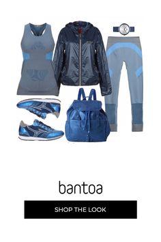 Completo per fare esercizio fisico in tessuto tecnico accompagnato da sneakers effetto usato in tinta. giacca a vento blu come lorologio più zaino in pelle sempre effetto consumano.