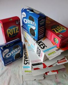 Collect 3 cereal boxes and some other cardstock boxes that fit inside them