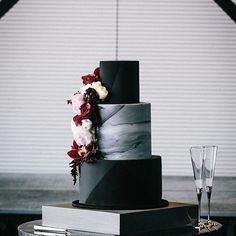 B.L.A.C.K O.N B.L.A.C.K Marble with black geometric painted on black. Congratulations @christinaivankovic and Marco. Wedding styling: @nomadstyling Venue: @thepiergeelong Photography: @elkandwillow Flowers: @mossindustry #blackweddingcake #marbleweddingcake #weddingcake