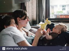 A same sex couple two women playing with their 6 month old baby girl Stock Photo, Royalty Free Image: 113018668 - Alamy