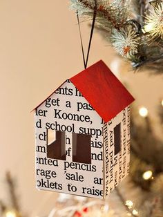 Craft tiny house ornaments out of recycled paper. Design a template and create tiny houses to hang on the tree. Vary the type of paper or ribbon to create a different effect.