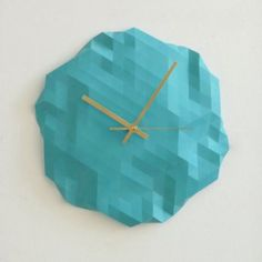 Turquoise wall clock - faceted design