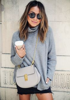 Turtle neck oversized sweater with black skirt