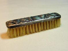 antique moustache brush with silver cap