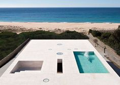 Alberto Campo Baeza designed this Cadiz, Spain waterfront home to be one with the Atlantic Ocean by creating a profile that is barren of detail except
