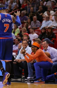 Carmelo Anthony #7 of the New York Knicks high fives Spike Lee. NOW THAT HAT IS KNICKS ORANGE.!