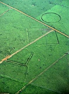 In cleared-away areas of the upper Amazon basin, researchers, using satellite imagery, have recently pinpointed a vast network of monumental earthworks, including geometrically aligned roads and structures, constructed by a hitherto unknown civilization.