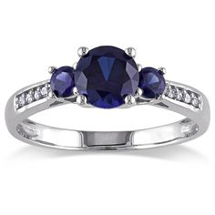 Miadora 10k White Gold Created Blue Sapphire Diamond Accent 3-stone... ($199) ❤ liked on Polyvore featuring jewelry, rings, blue, wide-band rings, pave ring, round cut rings, white gold band ring and blue sapphire band ring