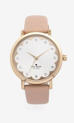 Crystal markers and scalloped detailing give this Kate Spade New York watch a feminine look.