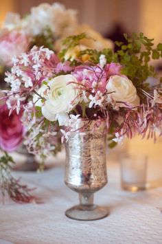 love these flowers in a mercury glass vase...
