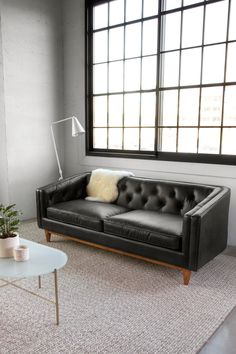 Tufted leather, medium-firm seats, and a classic silhouette. Black Leather Sofas, Black Sofa, White Curtains, White Bedding, Leather Furniture, Find Furniture, Mid Century Modern Sofa, Tufted Sofa, Bedroom Black