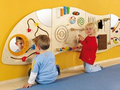 """The HABA 3 Piece Panel Learning Wall Toy is perfectly sized for busy toddlers. Packed with sensory experiences that promote the development of fine motor skills"" Interactive Walls, Interactive Learning, Toddler Play Area, Sensory Wall, Sensory Boards, Church Nursery, Curve Design, Indoor Playground, Waiting Rooms"
