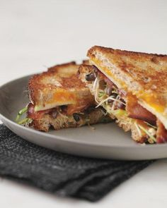 Grilled Cheese with Bacon, Apple, and Sprouts - There's nothing like a grilled-cheese-and-bacon sandwich. When you add slices of crisp apple and fresh-tasting sprouts to balance the richness, why, you have yourself a new instant classic. Sprout Recipes, Apple Recipes, Lunch Recipes, Healthy Recipes, Sandwich Recipes, Pork Recipes, Cooker Recipes, Healthy Food, Bagels