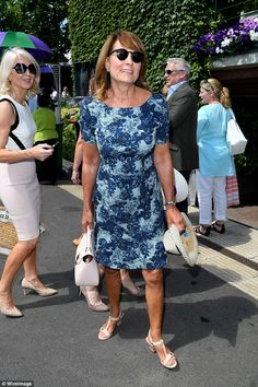 Shady lady! Carole Middleton kept her cool in a blue floral dress and dark sunglasses for her second visit to Wimbledon 10 Jul 2017