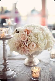 Centerpiece -  love the colors, a little too round, hydrangeas are ok as long as long as they have NO GREEN