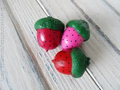 Strawberry Acorn Magnets...just paint the acorns and glue a magnet to the back. So clever!