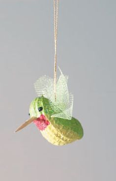 My oldest needs to make a hummingbird for her kindergarten class. This is adorable and I think I will have her make a couple of these and have them sitting on a feeder.